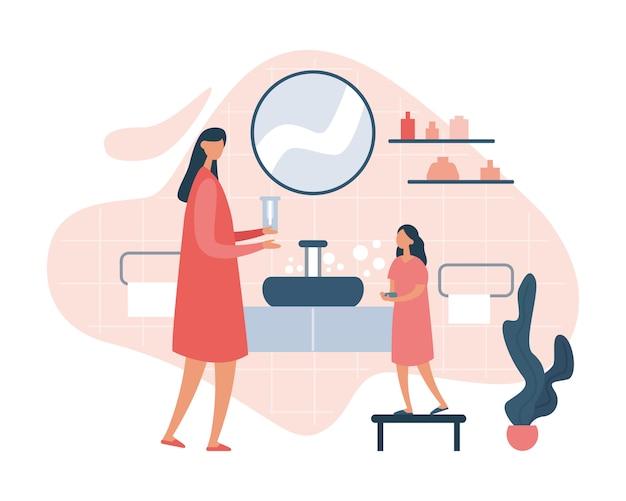 Mãe ensinando filha a lavar as mãos corretamente