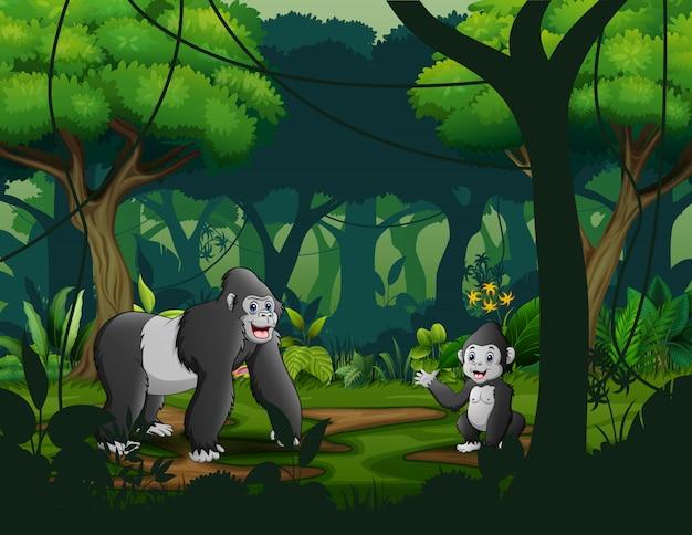 Mãe gorila com seu bebê na floresta