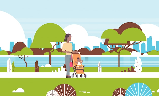 Mãe nova, e, bebê recém-nascido, menino, em, carrinho criança andar parque urbano, empurrar, carrinho bebê, com, criança
