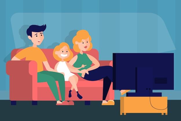 Mãe, pai e filha assistem tv em casa.