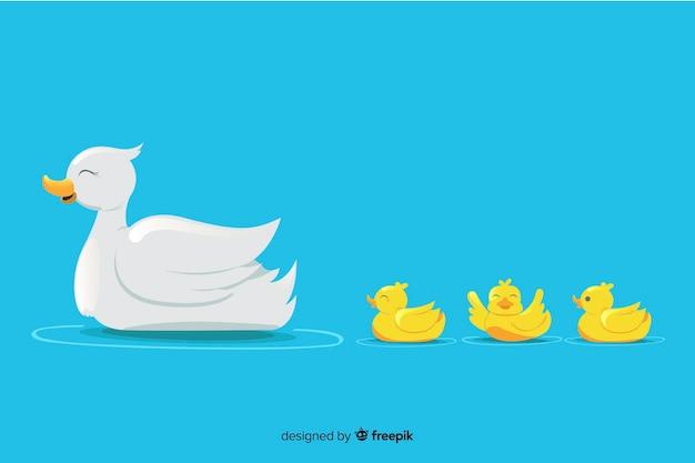 Mãe pato e seus pequenos patinhos na água