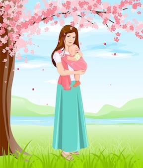 Mãe, segurando o bebê no sling. jovem mãe sob uma árvore florescendo
