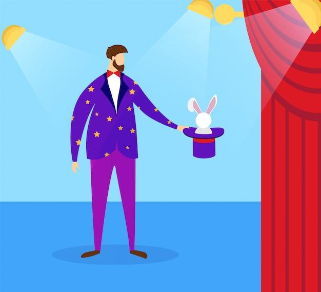 Mágico em traje segurando cartola com coelho.