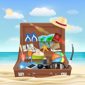 Mala aberta com objeto de viagem de praia na praia