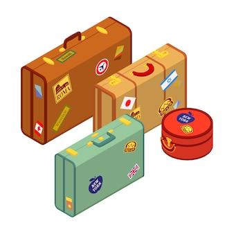 Malas de viajantes com os adesivos
