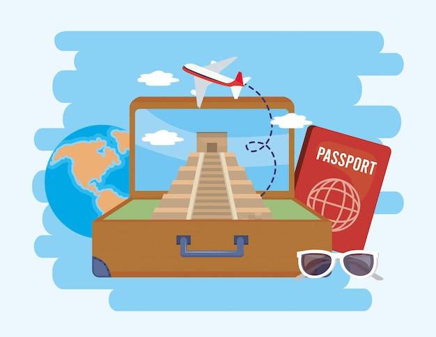 Maleta com templo de inscrição e passaporte com óculos de sol