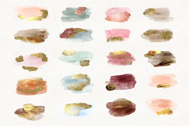 Manchas de aquarela pintadas à mão com ouro e glitter