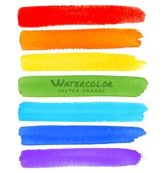 Manchas de pincel aquarela de arco-íris.