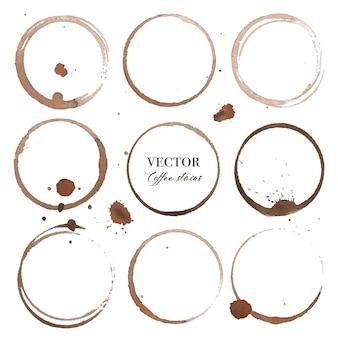 Manchas do café, textura do pulverizador do respingo de brown isolada no fundo branco.