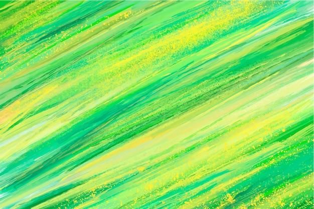 Mão abstrata pintada fundo verde