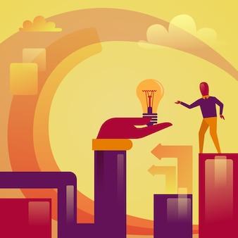 Mão abstrata que guarda o conceito startup novo do desenvolvimento da ideia do homem de negócio da ampola