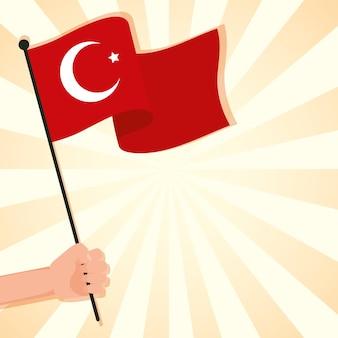 Mão acenando com a bandeira da turquia isolado