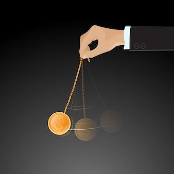 Mão balançando a moeda de ouro