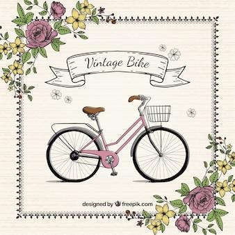 Mão bicicleta desenhado com flores fundo vintage