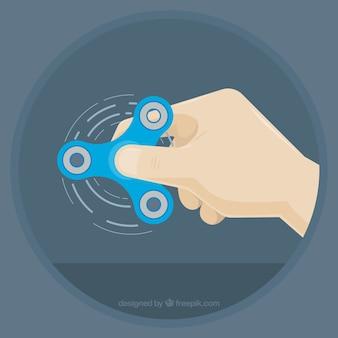 Mão brincando com um girador azul