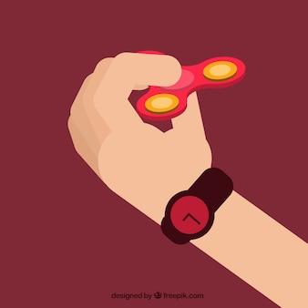 Mão brincando com um girador vermelho