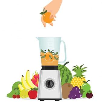 Mão colocando frutas laranja no liquidificador.
