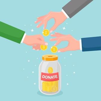 Mão colocando moedas em frasco de vidro. doe, dê dinheiro, caridade, voluntariado. caixa de doação