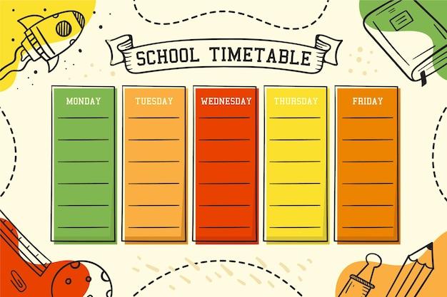 Mão colorida desenhada de volta ao calendário escolar