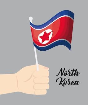 Mão com a bandeira da coreia do norte
