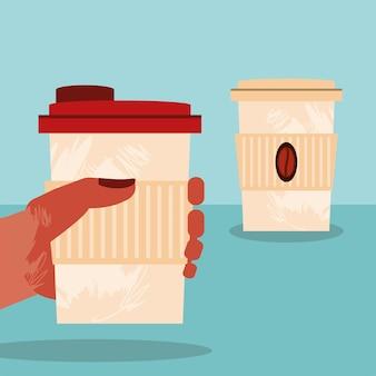 Mão com café em descartáveis