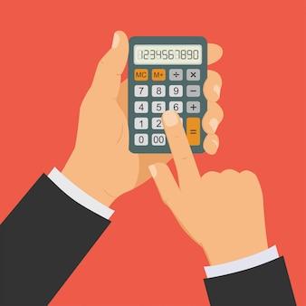 Mão com calculadora, homem segurando a calculadora na mão.