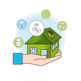 Mão com casa e cabo de alimentação para cuidar do meio ambiente
