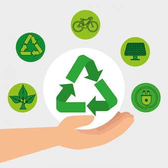 Mão com elemento de reciclagem e conservação de ecologia