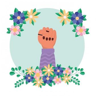 Mão com flores e folhas de empoderamento das mulheres