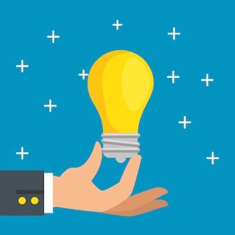 Mão com ícone de lâmpada