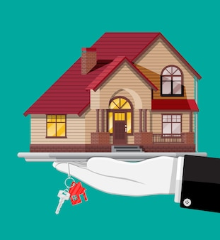 Mão com ilustração de uma pequena casa e chaves