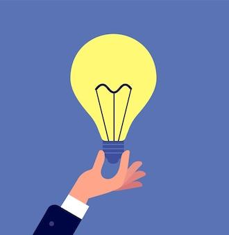 Mão com lâmpada