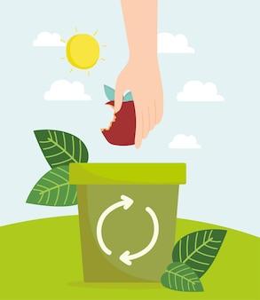 Mão com maçã na reciclagem de lixo