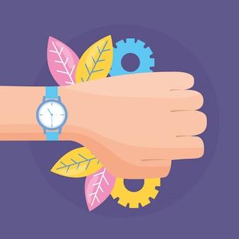 Mão com relógio de pulso