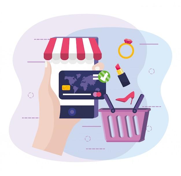 Mão com smartphone para compra on-line e cartão de crédito