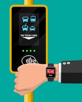 Mão com smartwatch e cartão do banco perto do terminal