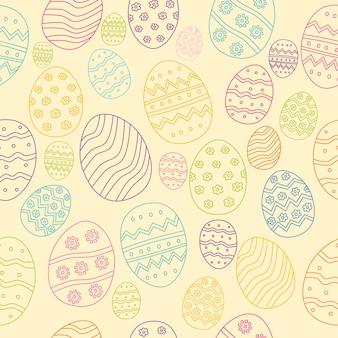 Mão da composição dos ovos da páscoa tirada colorida no fundo de creme.