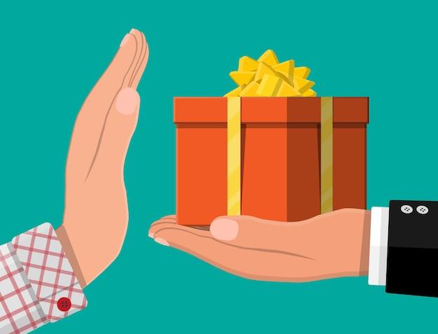 Mão dando uma caixa de presente para outra mão