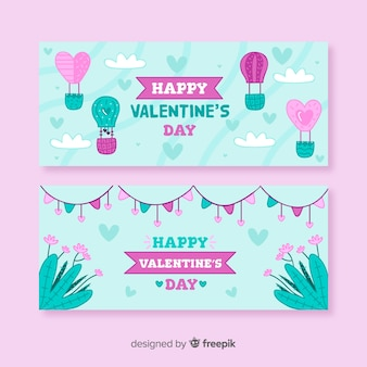 Mão de balão de ar quente desenhado banner dia dos namorados