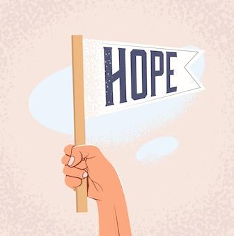 Mão de desenho animado, segurando a bandeira com legenda de esperança.