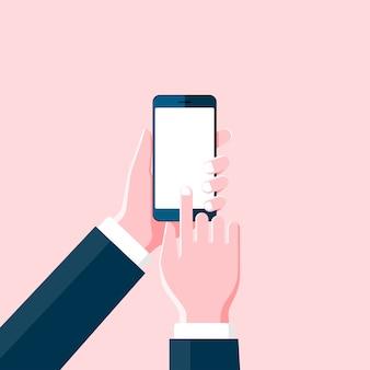 Mão de desenho animado segurando um smartphone e tocando em uma tela preta em branco no fundo rosa