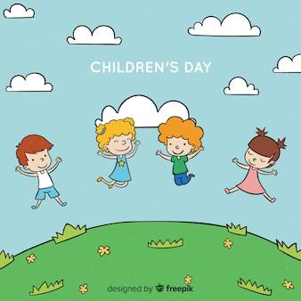 Mão de dia das crianças desenhado fundo de colina