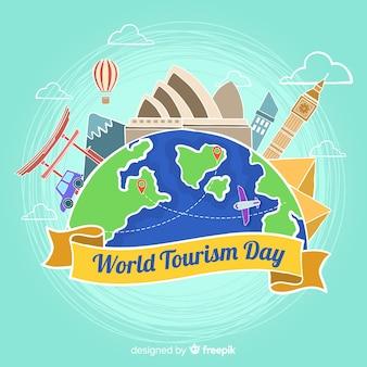 Mão de dia do turismo mundial desenhada