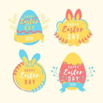 Mão de distintivo de dia de páscoa desenhada com fita e ovos coloridos