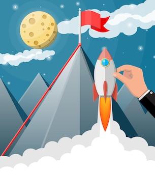 Mão de empresário com foguete espacial. bandeira no pico da montanha. sucesso nos negócios, meta, triunfo, cumprimento de metas. vencimento da competição. abertura de novos negócios. estilo simples de ilustração vetorial