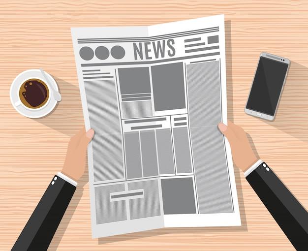 Mão de empresário dos desenhos animados, segurando o jornal