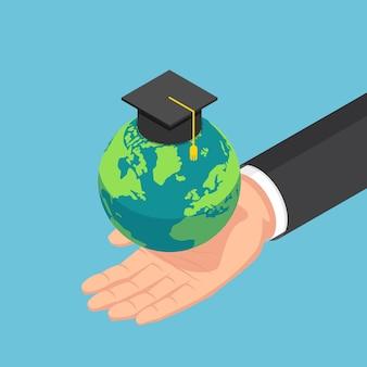 Mão de empresário isométrica 3d plana segurando o mundo com chapéu de formatura. conceito internacional de educação global.