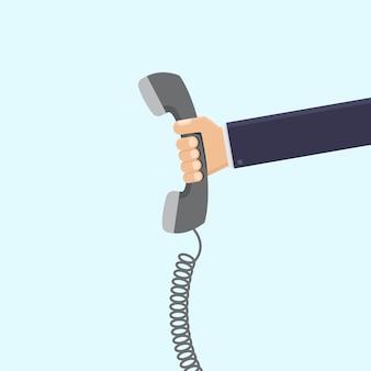 Mão de empresário segurando ilustração plana de telefone retro