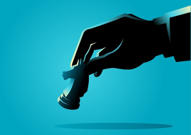 Mão de homem segurando o pedaço de cavaleiro de xadrez