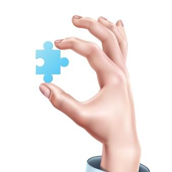 Mão de homem, segurando o quebra-cabeça azul realista
